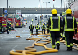 © Licensed to London News Pictures. 31/01/2012, London, UK. The A40 (flyover in back of picture)  road and flyover were closed during the incident . A huge fire, thought to be in an old dairy building containing small business is causing road and tube closures in Wood Lane, West London today 31 January 2012.  A large number of Fire Brigade and London Ambulance are in attendance. Photo credit : Stephen Simpson/LNP
