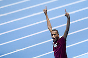 Mutaz Essa Barshim of Qatar celebrates his gold medal and World Champion title after men's high jump final during the IAAF Athletics World Indoor Championships 2014 at Ergo Arena Hall in Sopot, Poland.<br /> <br /> Poland, Sopot, March 9, 2014.<br /> <br /> Picture also available in RAW (NEF) or TIFF format on special request.<br /> <br /> For editorial use only. Any commercial or promotional use requires permission.<br /> <br /> Mandatory credit:<br /> Photo by &copy; Adam Nurkiewicz / Mediasport