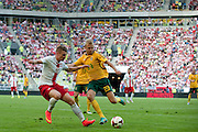 (L) Poland's Lukasz Piszczek fights for the ball with (R) Aurmas Vilkaitis from Lithuania during international friendly match between Poland and Lithuania at PGE Arena in Gdansk, Poland.<br /> <br /> Poland, Gdansk, June 06, 2014<br /> <br /> Picture also available in RAW (NEF) or TIFF format on special request.<br /> <br /> For editorial use only. Any commercial or promotional use requires permission.<br /> <br /> Mandatory credit:<br /> Photo by &copy; Adam Nurkiewicz / Mediasport