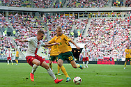 (L) Poland's Lukasz Piszczek fights for the ball with (R) Aurmas Vilkaitis from Lithuania during international friendly match between Poland and Lithuania at PGE Arena in Gdansk, Poland.<br /> <br /> Poland, Gdansk, June 06, 2014<br /> <br /> Picture also available in RAW (NEF) or TIFF format on special request.<br /> <br /> For editorial use only. Any commercial or promotional use requires permission.<br /> <br /> Mandatory credit:<br /> Photo by © Adam Nurkiewicz / Mediasport
