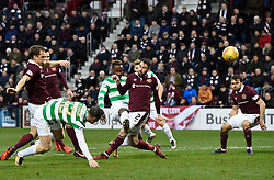 CelticÕs Moussa Dembele shoots for goal as he is tackled by Hearts Michael Smith during the Ladbrokes Scottish Premiership match at Tynecastle Stadium, Edinburgh. PRESS ASSOCIATION Photo. Picture date: Sunday December 17, 2017. See PA story SOCCER Hearts. Photo credit should read: Ian Rutherford/PA Wire. EDITORIAL USE ONLY