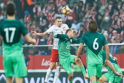 Wroclaw, Poland - 2016 November 14: Artur Jedrzejczyk of Poland fights for the ball with Nik Omladic of Slovenia during Poland v Slovenia - International Friendly Soccer Match at Municipal Stadium on November 14, 2016 in Wroclaw, Poland.<br /> <br /> Adam Nurkiewicz declares that he has no rights to the image of people at the photographs of his authorship.<br /> <br /> Picture also available in RAW (NEF) or TIFF format on special request.<br /> <br /> Any editorial, commercial or promotional use requires written permission from the author of image.<br /> <br /> Mandatory credit:<br /> Photo by © Adam Nurkiewicz / Mediasport