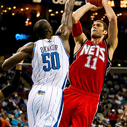 December 22, 2010; New Orleans, LA, USA; New Jersey Nets center Brook Lopez (11) shoots over New Orleans Hornets center Emeka Okafor (50) during the third quarter at the New Orleans Arena. The Hornets defeated the Nets 105-91. Mandatory Credit: Derick E. Hingle