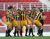 Photo: Lee Earle.<br /> Swindon Town v Port Vale. Coca Cola League 1. 08/10/2005. Port Vale players congratulate Micky Bell after he scored their first goal.