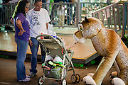 Oct 14, 2008 -- PHOENIX, AZ: A family with a stuffed animal on the midway at the Arizona State Fair. The Arizona State Fair started Oct.  10 and runs through Nov. 2. Carnival and midway workers who have worked the fair for years say attendance so far is much lower than in the past and people at the fair this year aren't spending as much money as they have in the past. Photo by Jack Kurtz / ZUMA Press