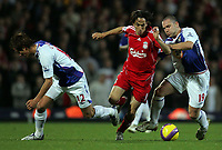 Photo: Paul Thomas/Sportsbeat Images.<br /> Blackburn Rovers v Liverpool. The FA Barclays Premiership. 03/11/2007.<br /> <br /> Yossi Benayoun (Red) is tackled by Blackburn pair David Dunn and Morten Gamst Pedersen (L).