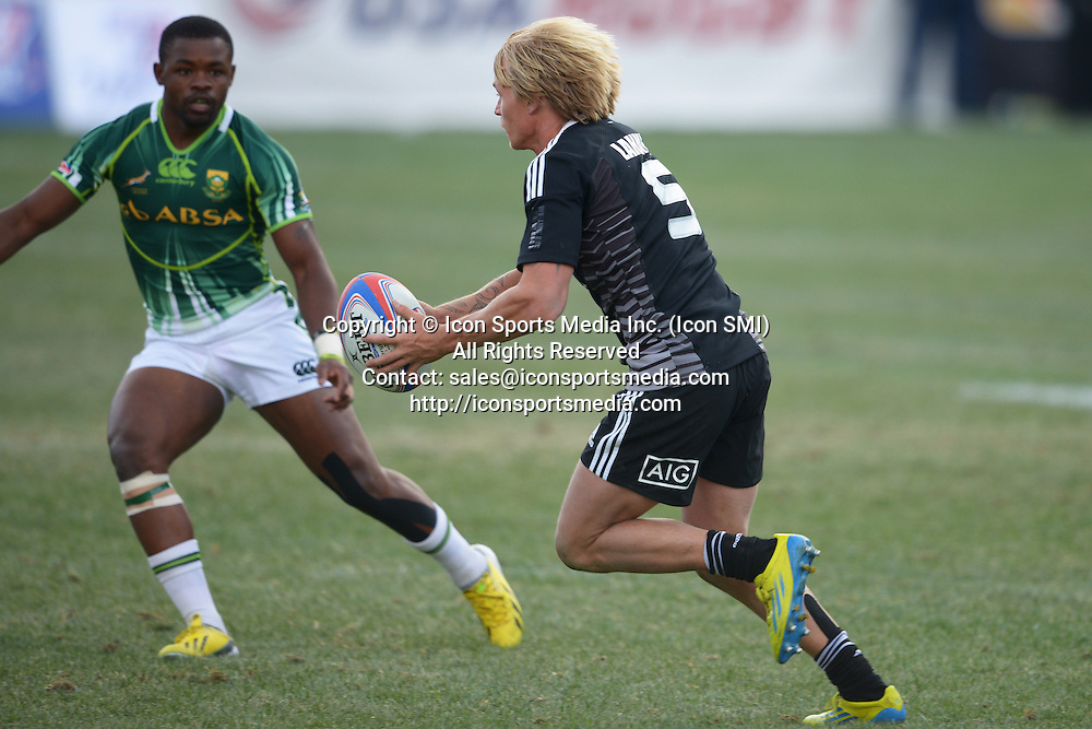 10 February 2013: Warwick Lahmert (5) of New Zealand tries to run past Tshotsho Mbovane (11) of South Africa in the Cup final of round 5 of the HSBC Sevens World Series of Rugby at Sam Boyd Stadium in Las Vegas, Nevada. South Africa defeated New Zealand 40-21.