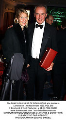 The DUKE & DUCHESS OF ROXBURGHE at a dinner in London on 12th November 2003.POL 215