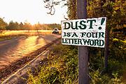 BC00650-00...MONTANA - Sign warning about dust outside Polebridge.