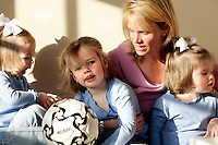 Sports agent Molly Fletcher plays with her daughters before heading to work on Wednesday morning, March 22, 2006. Fletcher juggles a busy family life with her more than full-time job representing several top sports personalities.<br />