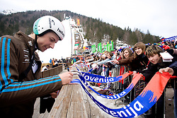 Simon Ammann of Switzerland with fans during Flying Hill Individual Qualifications at 1st day of FIS Ski Flying World Championsghips Planica 2010, on March 18, 2010, Planica, Slovenia.  (Photo by Vid Ponikvar / Sportida)