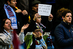 A Burnley fan holds up a sign as the crowd give an applause in support of former Burnley player Clarke Carlisle who was injured recently in a car accident - Photo mandatory by-line: Rogan Thomson/JMP - 07966 386802 - 26/12/2014 - SPORT - FOOTBALL - Burnley, England - Turf Moor Stadium - Burnley v Liverpool - Boxing Day Christmas Football - Barclays Premier League.