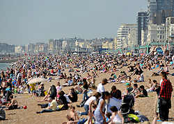 © licensed to London News Pictures. LONDON UK. 21/04/11.People flock to Brighton Beach today to catch the sunshine before the start of the Easter Bank Holiday in Britain. Temperatures are set to continue to rise over the weekend. Photo credit should read Stephen Simpson/LNP