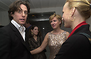 Hugh Grant and Tina Brown Talk pre-Golden Globes party. Mondrian Hotel.West Hollywood, California USA  20 January 2001. © Copyright Photograph by Dafydd Jones 66 Stockwell Park Rd. London SW9 0DA Tel 020 7733 0108 www.dafjones.com