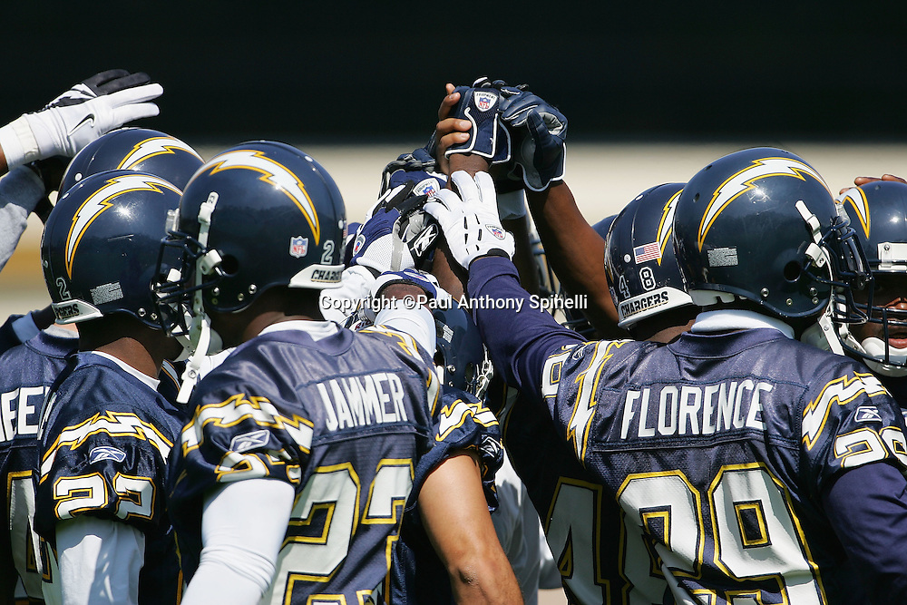 SAN DIEGO - JUNE 10:  San Diego Chargers players and coaches hold hands in unison after mini camp at Chargers Park on June 10, 2006 in San Diego, California. ©Paul Anthony Spinelli