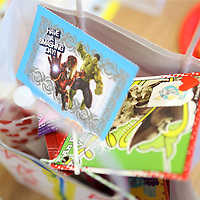 Lauren Wood   Buy at photos.djournal.com<br /> Valentines fill first grader Lennox White's bag during the Valentine's Day party Friday afternoon in Carol Elliott's first grade classroom.