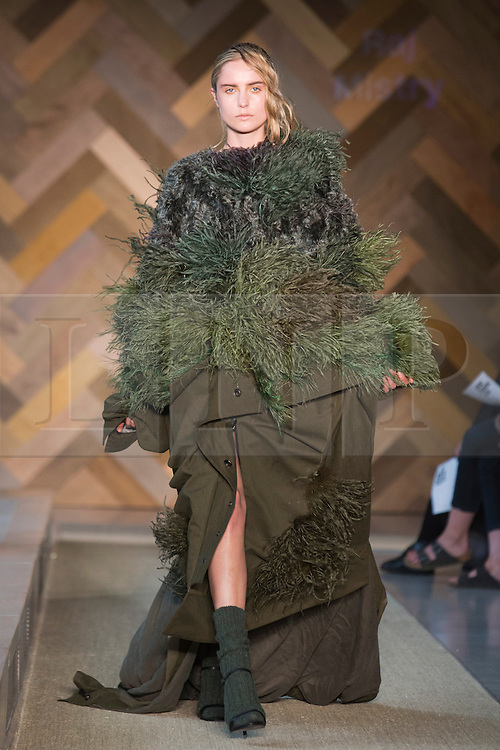 © Licensed to London News Pictures. 29/05/2014. London, England. Collection by xxxx. 30 students of the Royal College of Art's prestigious MA Fashion programme presented their final collections in  a runway show at the RCA building in Kensington. Photo credit: Bettina Strenske/LNP