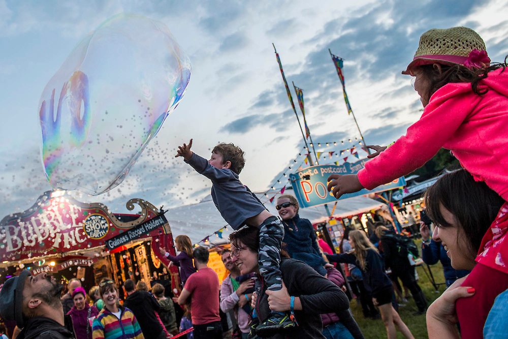 Bubble Inc entertain the young and old with tiny and gigantic bubbles - The 2016 Latitude Festival, Henham Park, Suffolk.