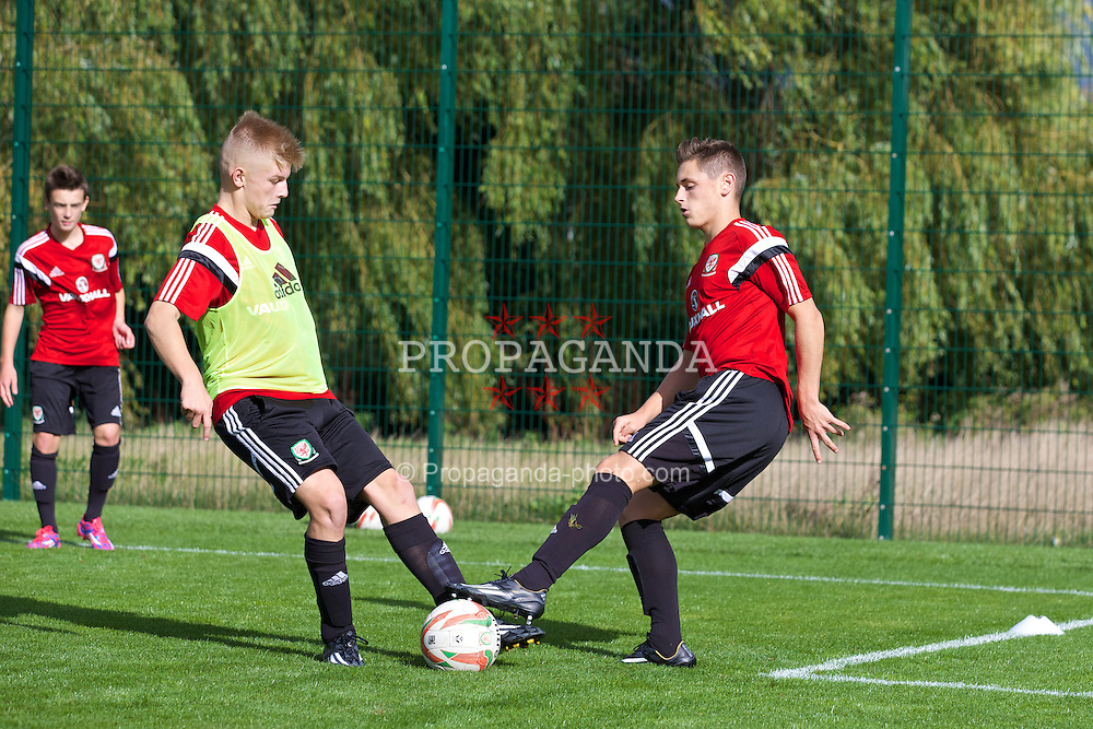 NEWPORT, WALES - Wednesday, September 24, 2014: Wales' Theo Llewellyn and Kieran Evans training at Dragon Park ahead of the Under-16's International Friendly match against France. (Pic by David Rawcliffe/Propaganda)