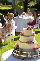 Wedding cake guests at tables in background