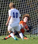 SSOUTH09<br /> Central Bucks South's Colin Fagan #10 scores a goal against Pennridge's Brody Giblin in the second half Thursday October 8, 2015 at Central Bucks South in Warrington, Pennsylvania. (William Thomas Cain/For The Inquirer)