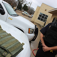 RAY VAN DUSEN/BUY AT PHOTOS.MONROECOUNTYJOURNAL.COM<br /> Amory police officer Rick Jones wears one of the 10 new Level 4 tactical vests the department purchased thanks to help from the community. Another style vest, designated for the department's special response team,  is pictured on the hood of a police car.