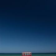 Oman, Ra's al-Hadd. February/17/2008...A red fishing truck on the beaches of Ra's al-Hadd.