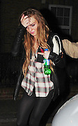 28.FEB.2009 - LONDON<br /> <br /> A HAPPY LINDSEY LOHAN LEAVING HER RESIDENCE IN CHELSEA AT 9.30PM WITH GIRLFRIEND SAM RONSON WITH A COUPLE OF DVD'S THEY TOOK TO A FRIENDS HOUSE TO CHILL OUT, THEY THEN HEADED ONTO BUNGALO 8 CLUB TO MEET SAM'S BROTHER MARK AND DANIEL MERRYWETHER WHERE THEY PARTIED TILL 3.30AM AND THEN WENT ONTO A FRIENDS HOUSE IN SHOREDITCH WITH MARK. MARK THEN LEFT WITH A MYSTERY GIRL AT 4.30AM BEFORE LINDSEY AND SAM HAD ONE OF THERE LEGENDRY ARGUMENTS SCREAMING AT EACHOTHER INSIDE THE HOUSE UNTILL THEY LEFT AT 6.00AM WITH THERE HANDS COVERING THERE FACE, THEN WHEN THEY GOT BACK TO THERE HOUSE THEY WERE AGAIN SCREAMING AT EACHOTHER BEFORE LINDSEY CAME OUT THE CAR CRYING AND WIPING HER EYES. THE ARGUMENT  DIDNT STOP THOUGH AS THEY CONTINUED THE ARGUMENT INSIDE THE HOUSE AND YOU COULD HEAR THEM SHOUTING ABUSE AT EACHOTHER FROM OUTSIDE THE HOUSE THIS CONTINUED TILL 8.30AM BEFORE IT ALL WENT QUIET.<br /> <br /> BYLINE MUST READ : EDBIMAGEARCHIVE.COM<br /> <br /> **THESE PICTURES ARE EXCLUSIVE**<br /> *THIS IMAGE IS STRICTLY FOR UK NEWSPAPERS ONLY FOR WEB USE PLEASE CONTACT EDBIMAGEARCHIVE - 0208 954 5968*