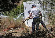 Scotland Yard forensic technician mapping a place where there have seen abnormal evidence in the ground a tent will be erected around this plot today, Praia da Luz where do searches through the body of Maddie McCann.<br /> ©Exclusivepix
