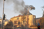 Burning houses during the wildfire in the city of Haifa, Israel in November 2016