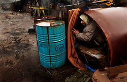 CALAIS , FRANCE - 1-1-2003 - On new years day refugees from Afghanistan and Iraq find shelter from the rain and cold in a sewer pipe near the port of Calais.  (PHOTO © JOCK FISTICK)