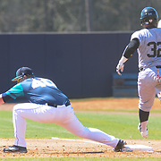 UNCW's Corey Dick forces Maryland's Kevin Martir our at first Sunday March 8, 2015 at Brooks Field. (Jason A. Frizzelle)