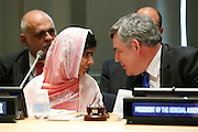 UN Special Envoy for for Global Education, Gordon Brown, shares a moment with Malala Yousafzai as she celebrates her 16th birthday by addressing hundreds of young leaders who support the U.N. Secretary General's Global Education First Initiative, during 'Malala Day' at the United Nations in New York, July 12, 2013. Malala continues to campaign for every child's right to education after surviving an attack by the Taliban in Pakistan last year. (INSIDER IMAGES/Stuart Ramson for UN Foundation)