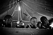 Children attend school in a camp for those displaced by the recent earthquake in Petionville, outside Port-au-Prince, Haiti.