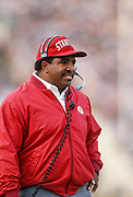BERKELEY, CA - NOV 1990:  Dennis Green, Stanford University Head Coach, watches from the sidelines during a Stanford Cardinal football game played in November 1990 at Stanford Stadium in Palo Alto, California. (Photo by David Madison/Getty Images)