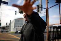 "Vallejo High School student Brandon Bridges, 16, walks home from school, passing the corner gas station, on Nebraska street, frequented by high school students and the scene mob assault by teenagers last week on a city construction worker, in Vallejo, Ca., on Wednesday, Feb. 10, 2010. Bridges says crime isn't linked to the city's financial situation or the loss of police officers, but ""because people aren't using their brains anymore."""