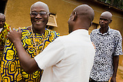 Kevin Kouassi Gallet greets his father Hyacinthe Kouassi Koffi as he arrives to his parents home in Tano Akakro, Cote d'Ivoire on Saturday June 20, 2009..