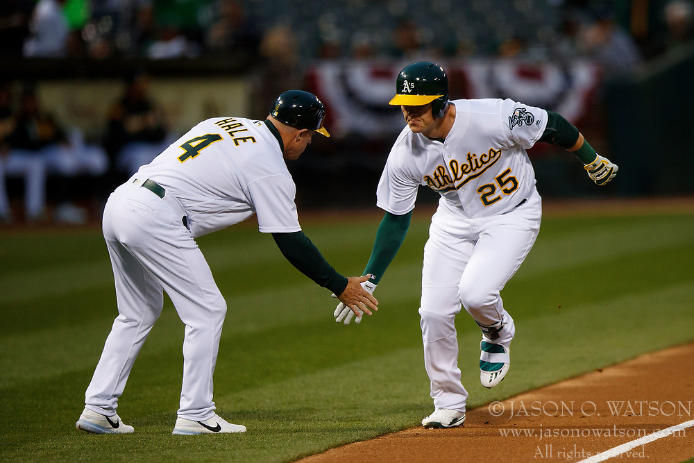 OAKLAND, CA - APRIL 04:  Ryon Healy #25 of the Oakland Athletics is congratulated by third base coach Chip Hale #4 after hitting a home run against the Los Angeles Angels of Anaheim during the first inning at the Oakland Coliseum on April 4, 2017 in Oakland, California. The Los Angeles Angels of Anaheim defeated the Oakland Athletics 7-6. (Photo by Jason O. Watson/Getty Images) *** Local Caption *** Ryon Healy; Chip Hale