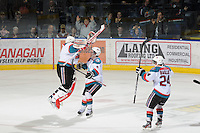 KELOWNA, CANADA - FEBRUARY 18: Adam Brown #1 and Jesse Lees #2 of the Kelowna Rockets  celebrate the win via shoot out against the  Red Deer Rebels at the Kelowna Rockets on February 18, 2012 at Prospera Place in Kelowna, British Columbia, Canada (Photo by Marissa Baecker/Shoot the Breeze) *** Local Caption ***