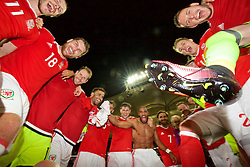 TOULOUSE, FRANCE - Monday, June 20, 2016: Wales players celebrate in a team-huddle after the 3-0 victory over Russia and reaching the knock-out stage during the final Group B UEFA Euro 2016 Championship match at Stadium de Toulouse. Sam Vokes, goalkeeper Owain Fon Williams, Hal Robson-Kanu, Joe Ledley, Ben Davies, captain Ashley Williams, Joe Allen, Jonathan Williams, Chris Gunter, goalkeeper Wayne Hennessey, Simon Church, David Edwards, goalkeeper Daniel Ward. (Pic by David Rawcliffe/Propaganda)