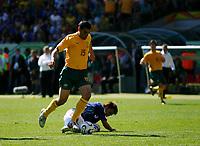 Photo: Glyn Thomas.<br />Australia v Japan. Group F, FIFA World Cup 2006. 12/06/2006.<br />Australia's John Aloisi (L) scores his side's third goal.