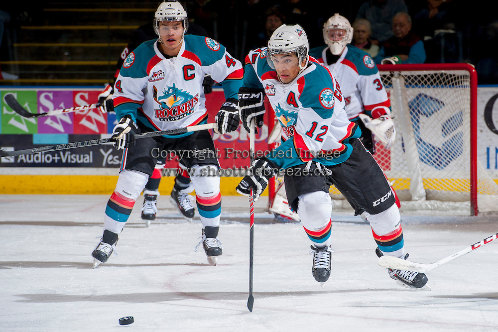 KELOWNA, CANADA -FEBRUARY 25: \Tyrell Goulbourne #12 of the Kelowna Rockets skates with the puck against the Prince George Cougars during first period on February 25, 2014 at Prospera Place in Kelowna, British Columbia, Canada.   (Photo by Marissa Baecker/Getty Images)  *** Local Caption *** Tyrell Goulbourne; Madison Bowey;