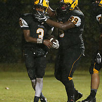 Ripley's Dorian Cox celebrates with quarterback Trey Blanchard after Blanchard scored a touchdown and the two-point conversion during Friday night's game against New Albany.