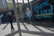 The day after UK Prime Minister Boris Johnson addressed the nation with his roadmap for the coming weeks and months during the Coronavirus pandemic lockdown, a Londoner walks past a mural created by the anonymous street artist known as 'Artful Dodger' (after Charles Dickens's pickpocket character in Oliver Twist), of a Muslim NHS (National Heath Service) nurse wearing a surgical face mask, at Elephant & Castle in south London, on 11th May 2020, in London, England.