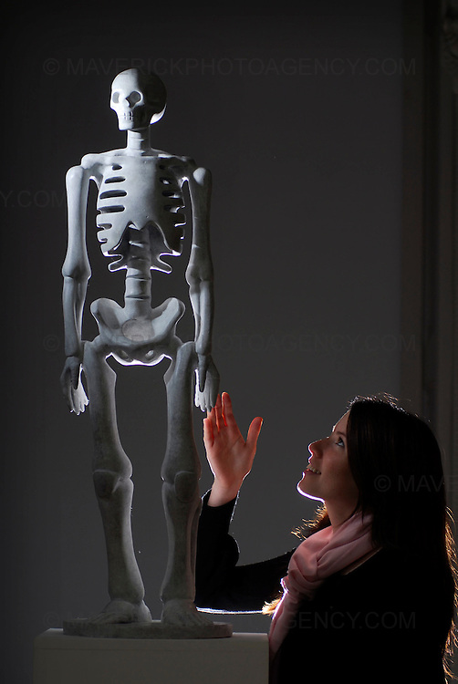 "A bronze skeleton created by the acclaimed sculptor Kenny Hunter was unveiled at Edinburgh University's Talbot Rice Gallery today.  The one meter tall white coated statue named ""The Unknown"" is being gifted to the University by its General Council, which marks its 150th anniversary this year.  Pictured Anna Smyth of the University admires the new installation."