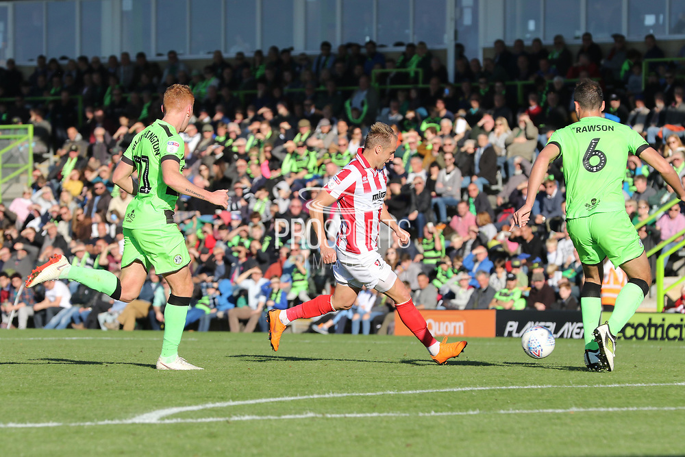 Luke Varney shoots during the EFL Sky Bet League 2 match between Forest Green Rovers and Cheltenham Town at the New Lawn, Forest Green, United Kingdom on 20 October 2018.
