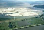 Nederland, Amsterdam, IJburg, 25-09-2002; Diemerzeedijk: voormalige vuilstortplaats van Gemeente Amsterdam, de vuilnisbelt is gesaneerd, het chemisch afval is onder een enkele meters dikke laag zand verborgen; het gesaneerde terrein zal in de toekomst recreatiegebied voor de bewoners van het nabijgelegen IJburg dienen; in de achtergrond:  grondwerkzaamheden op de eilanden van het nieuwe stadsdeel IJburg; milieuvervuiling, gif, zand, opspuiten, landaanwinning, bouw, woningbouw, stadsvernieuwing, planologie, stedebouw, infrastructuur, zie ook andere (detail)foto's van deze lokatie;<br /> luchtfoto (toeslag), aerial photo (additional fee)<br /> foto /photo Siebe Swart