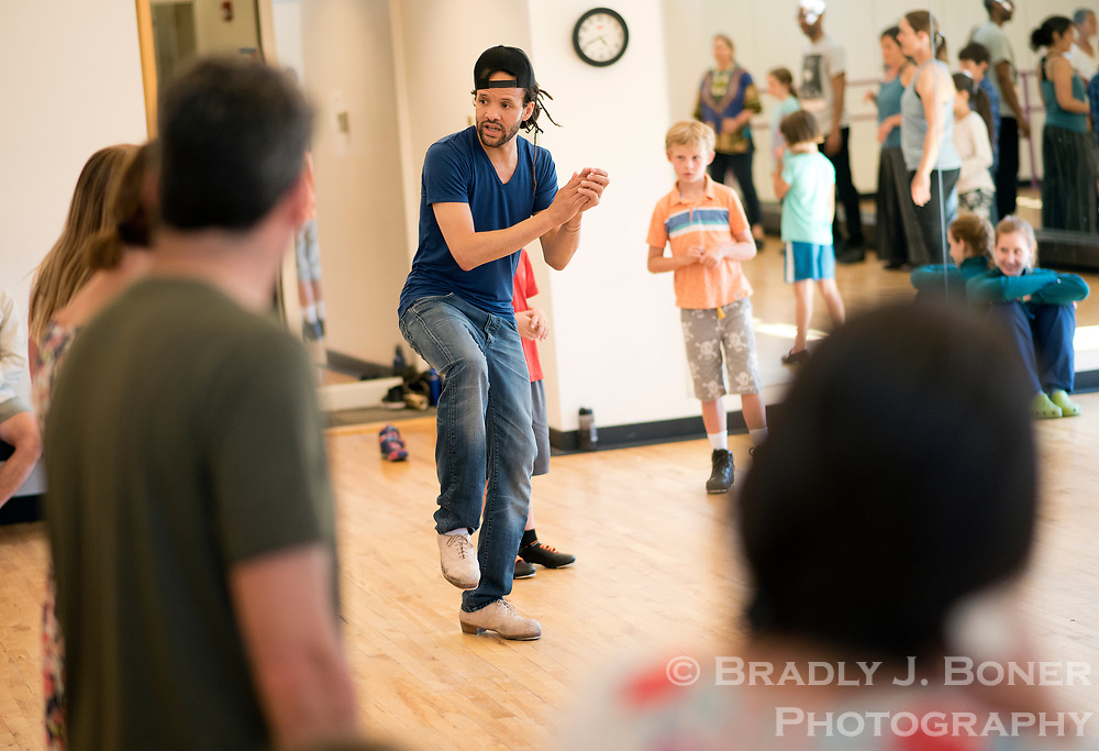 Professional tap dancer, actor and choreographer Savion Glover leads a tap dancing class in Dancers' Workshop Studio 4 on Tuesday at the Center for the Arts.