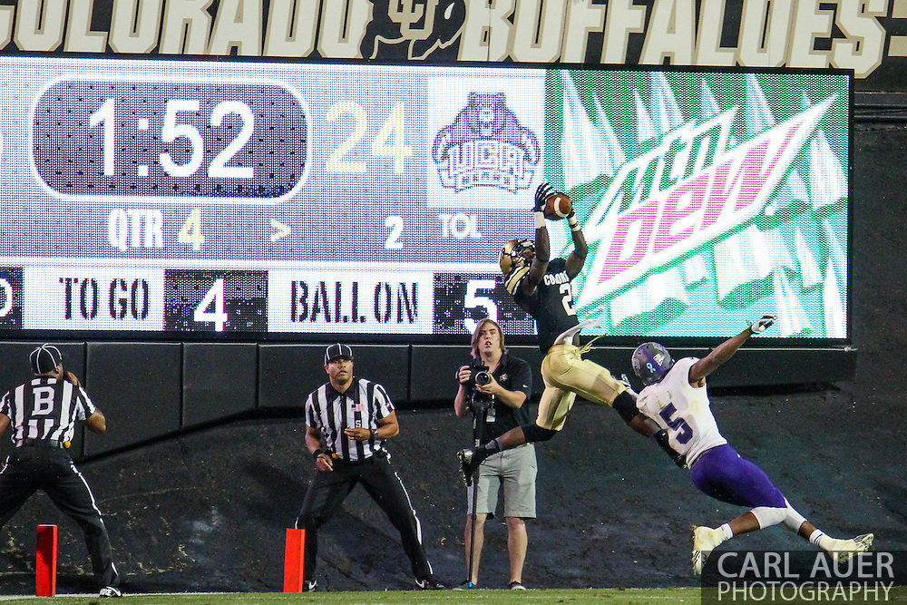 September 7th, 2013 - Colorado Buffaloes sophomore defensive back Kenneth Crawley (2) makes a game ending interception over University of Central Arkansas Bears junior wide receiver Dezmin Lewis (5) in the end zone in the NCAA football game between the University of Central Arkansas Bears and the University of Colorado Buffaloes at Folsom Field in Boulder, CO