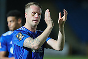 FC Halifax Town defender Nathan Clarke (4) applauds the fans after the Vanarama National League match between FC Halifax Town and Dover Athletic at the Shay, Halifax, United Kingdom on 17 November 2018.
